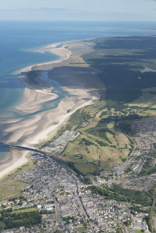 General oblique aerial view centred on Nairn with Culbin sands beyond, looking NE.
