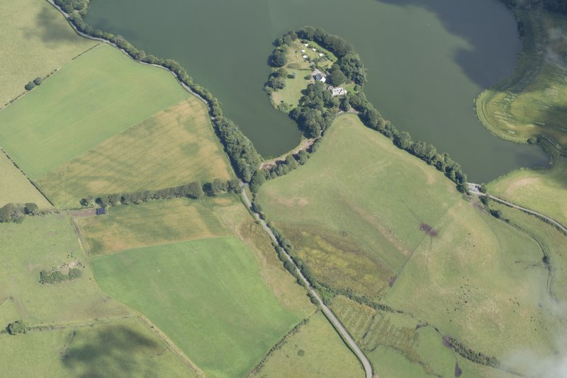 Oblique aerial view of Greenloch House, the site of Soulseat Abbey and the cropmarks of the ring ditch, looking NE.