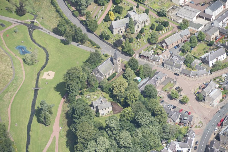 Oblique aerial view centred on the former Moat Park Church, looking NE.