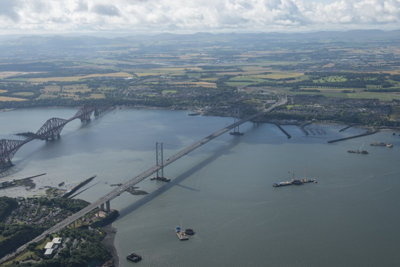 General oblique aerial view of the Queensferry Crossing under construction, looking SE.