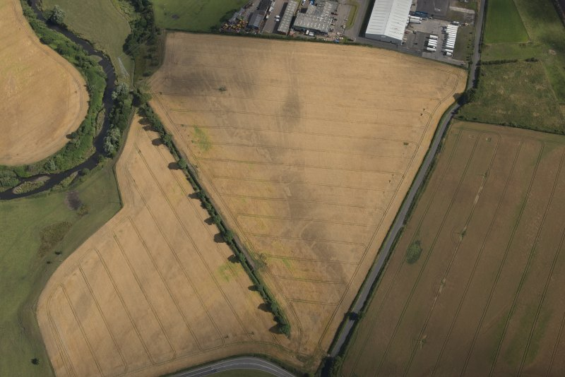 Oblique aerial view of the cropmarks of the Roman Temporary Camps, looking NNE.