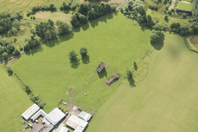 Oblique aerial view of Gilbertfield Castle, looking SE.