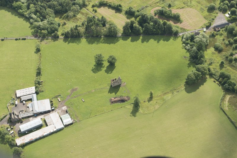 Oblique aerial view of Gilbertfield Castle, looking ESE.