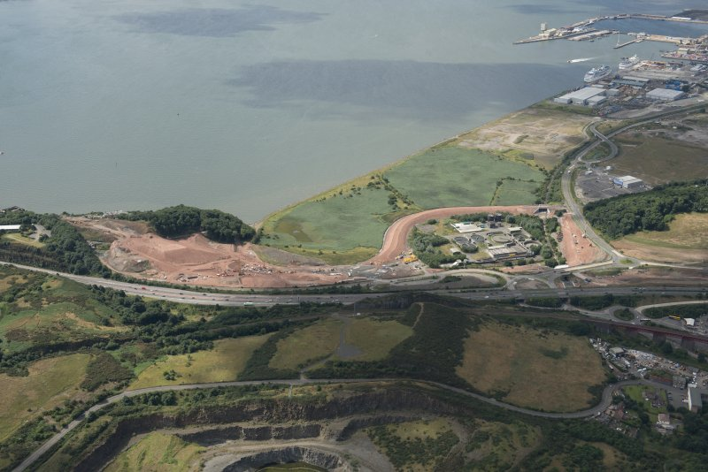 Oblique aerial view of the Queensferry Crossing under construction centred on the approach to the north bank, looking ESE.
