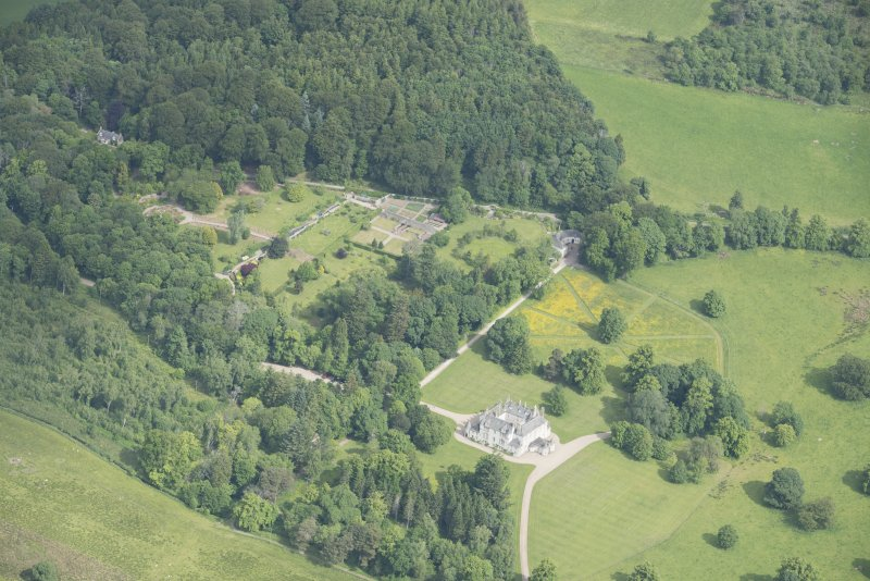 Oblique aerial view of Leith Hall and policies, looking to the NW.