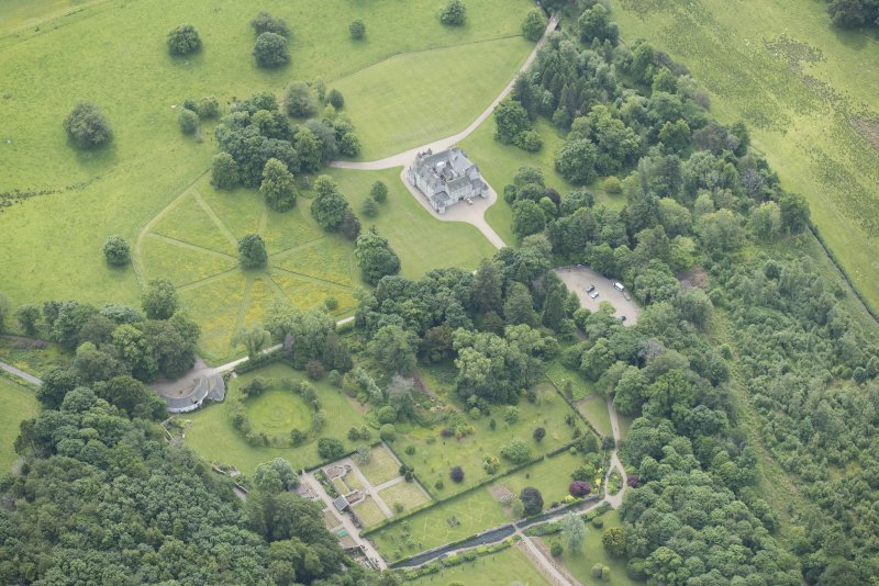 Oblique aerial view of Leith Hall and policies, looking to the SSE.