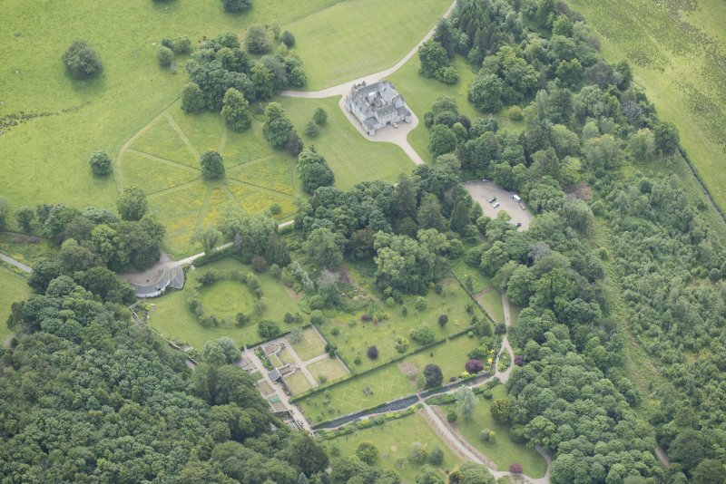 Oblique aerial view of Leith Hall and policies, looking to the SE.
