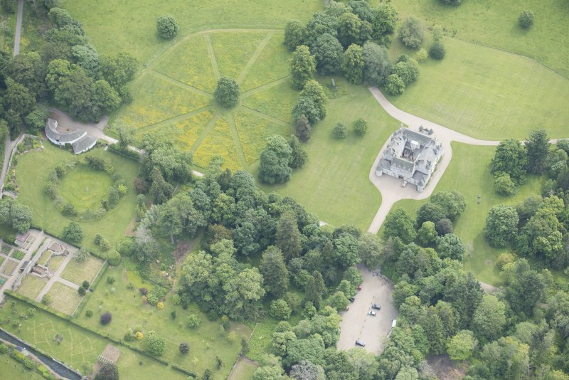 Oblique aerial view of Leith Hall and policies, looking to the E.