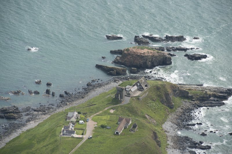 Oblique aerial view of Old Slains Castle, looking to the E.