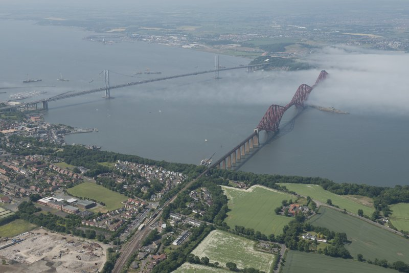 General oblique aerial view of the Forth Bridge, looking NW.