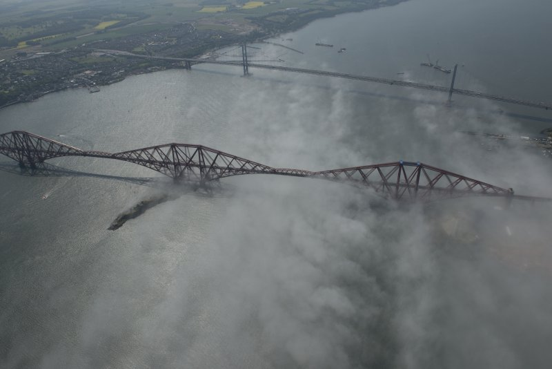 General oblique aerial view of the Forth Bridge and the road bridge, looking W.