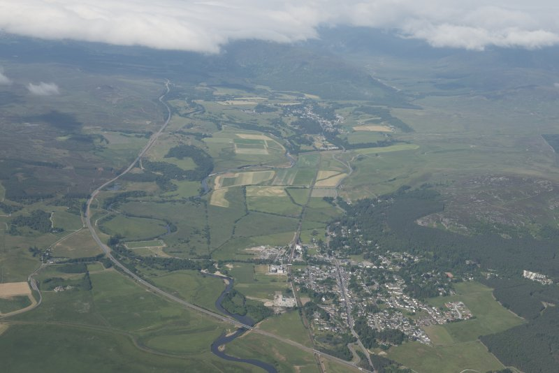 General oblique aerial view of Kingussie with Newtonmore beyond, looking WSW.