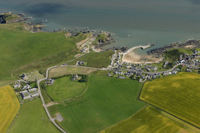 General oblique aerial view centred on Collieston, looking SE.