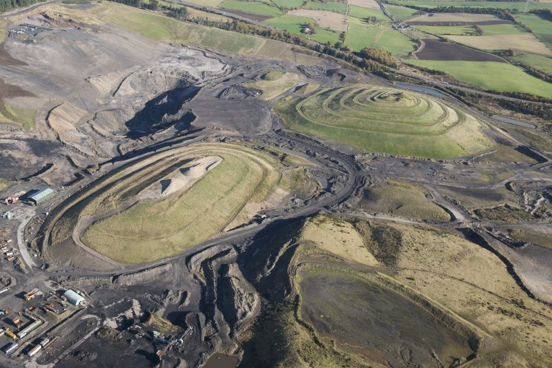General oblique aerial view of St Ninian's Open Cast Mine, centred on the Sculptured Landscape by Charles Jenks,  looking to the NNE.