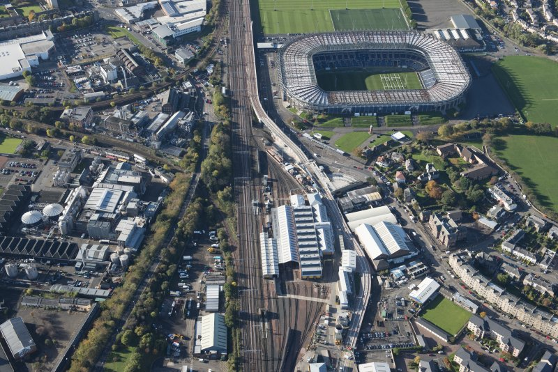 Oblique aerial view of the Edinburgh Tramway, Murrayfield Stadium and Haymarket Motive Power Depot, looking to the W.