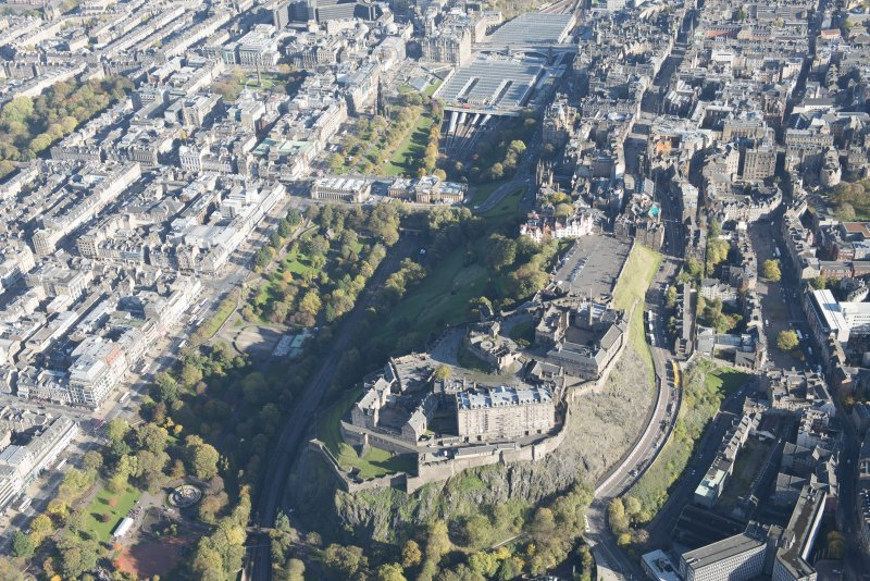 Oblique aerial view of Edinburgh Castle, Princes Street and the Edinburgh Tramway, looking to the NE.