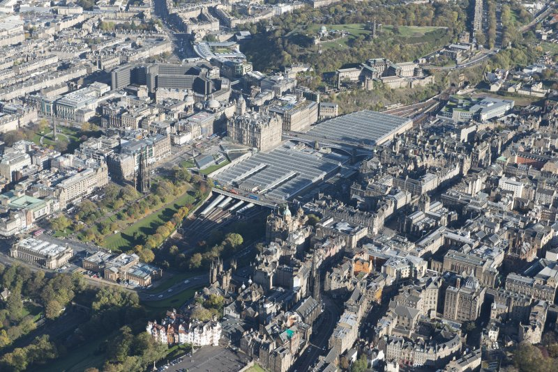 Oblique aerial view of Waverley Station, Balmoral Hotel and the High Street, looking to the NE.