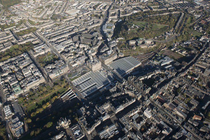 General oblique aerial view of the east end of Princes Street, including Waverley Station and the  Balmoral Hotel, looking to the NE.
