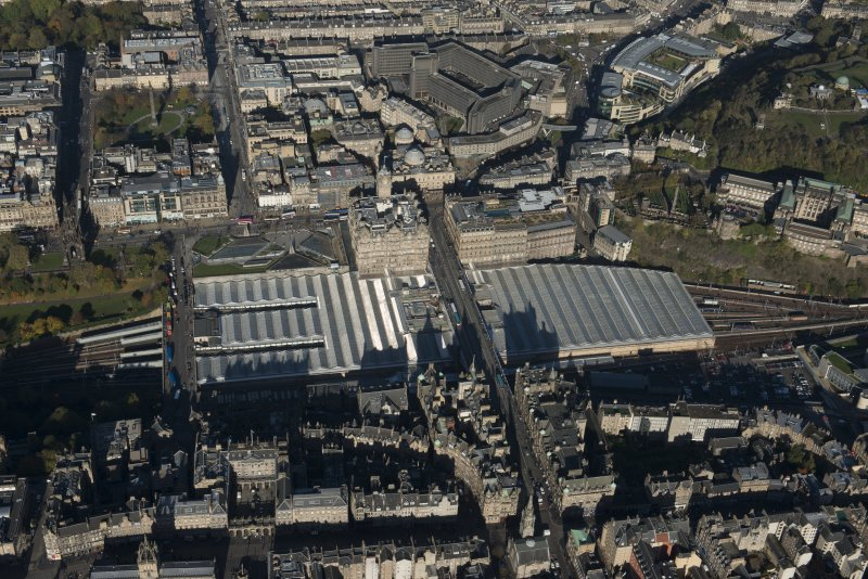Oblique aerial view of the site of Waverley Station and Balmoral Hotel, looking to the N.