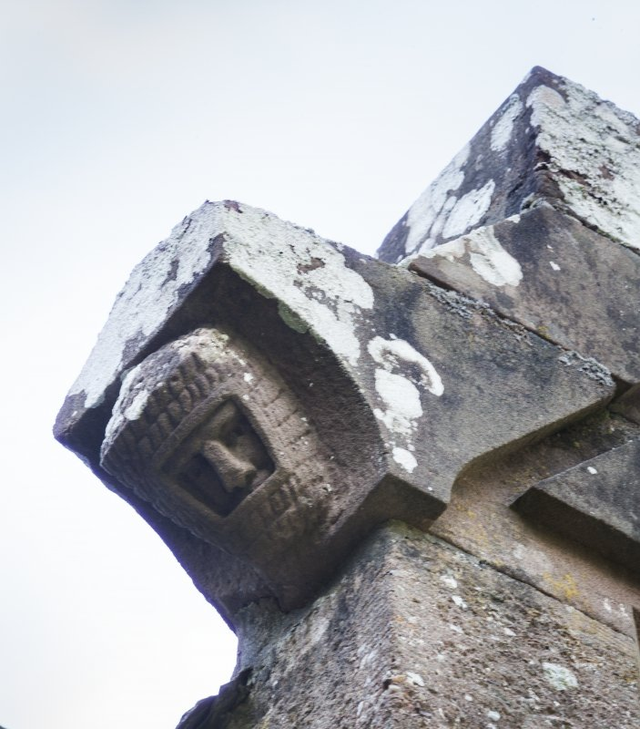 Detail of head on roof corbel.