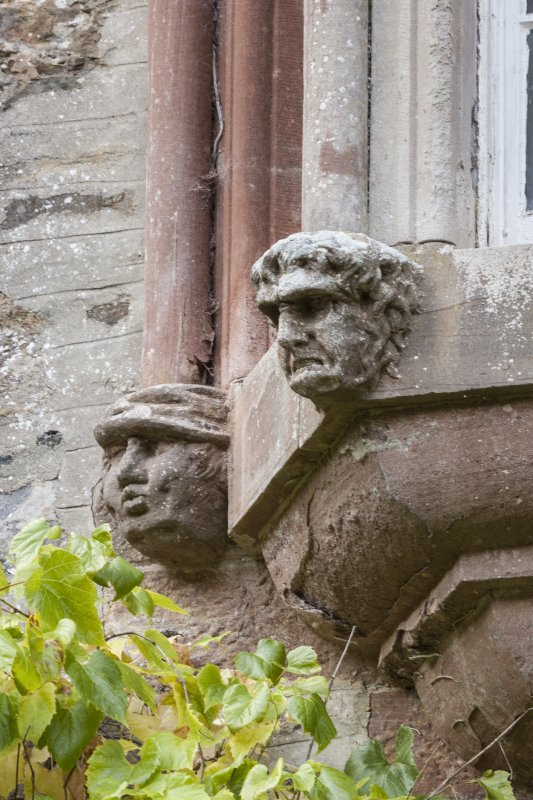 Detail of heads on oriel window.