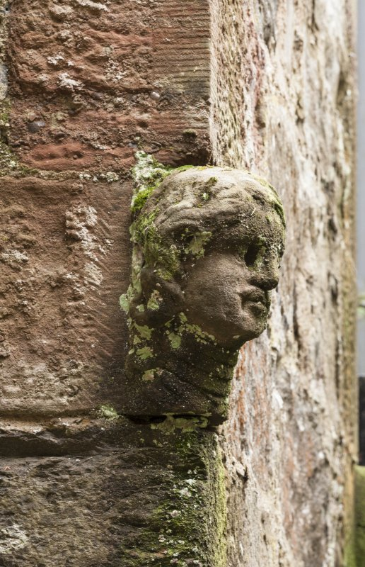 Detail of head in North east courtyard.