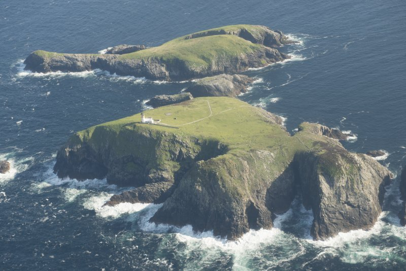 Oblique aerial view of the Flannan Isles, with the lighthouse on Eilean Mor in the foreground and Eilean Tighe beyond, looking to the S.