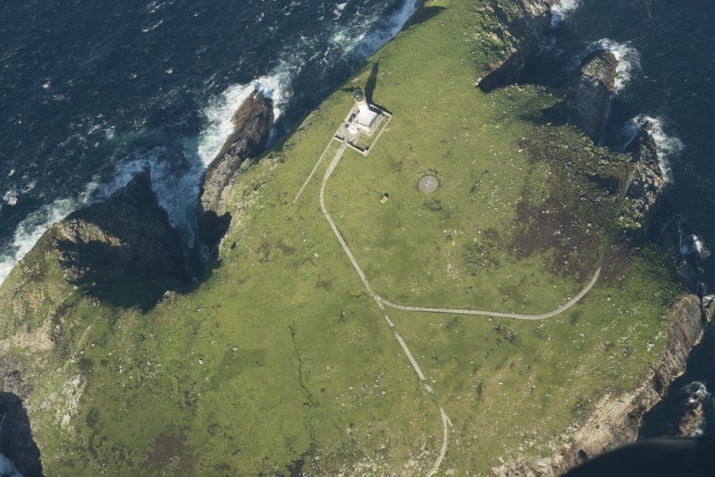 Oblique aerial view of the lighthouse and St Flannan's chapel on Eilean Mor, Flannan Isles, looking to the NE.