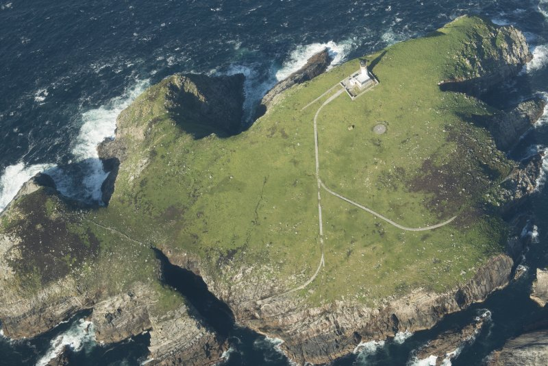 Oblique aerial view of the lighthouse and St Flannan's chapel on Eilean Mor, Flannan Isles, looking to the NNE.
