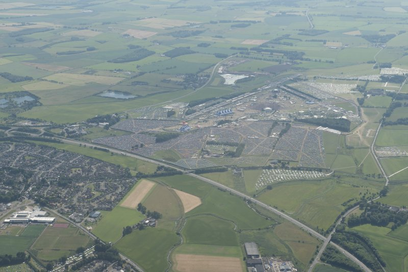 General oblique aerial view centred on the T in the Park festival at Balado, looking WSW.