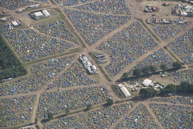 Oblique aerial view of the T in the Park festival at Balado, looking S.