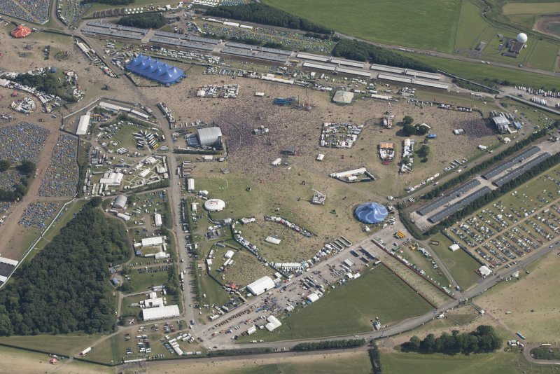 Oblique aerial view of the T in the Park festival at Balado, looking SSE.