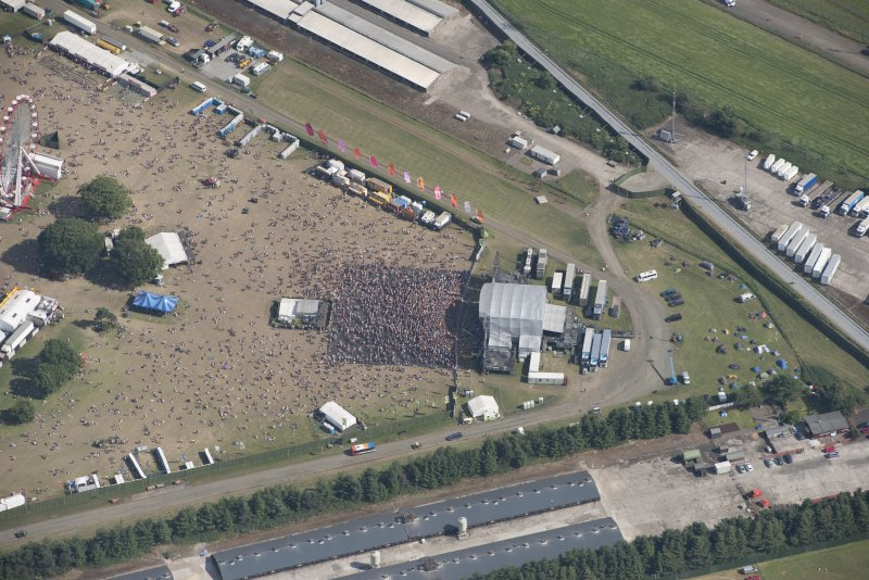 Oblique aerial view of the T in the Park festival at Balado, looking SE.