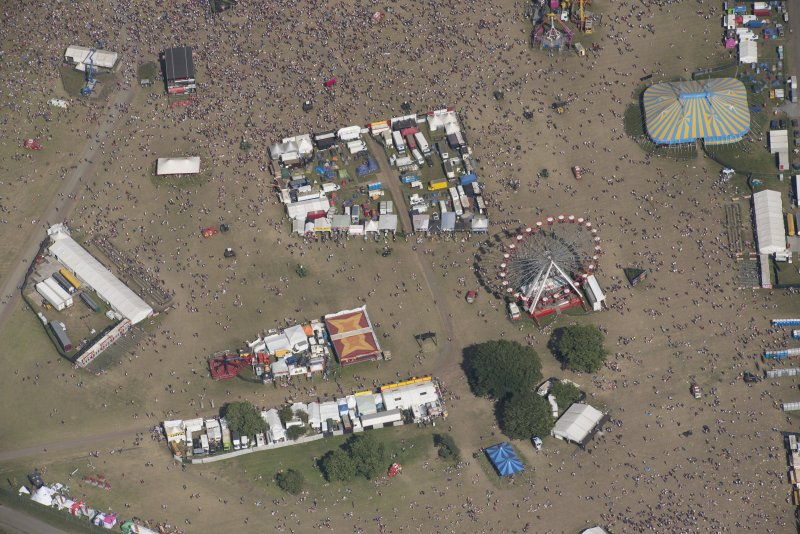 Oblique aerial view of the T in the Park festival at Balado, looking E.