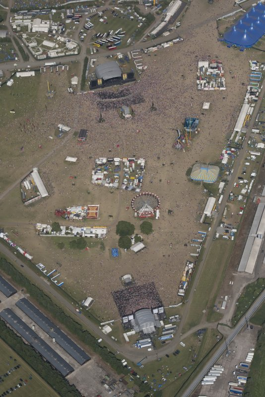 Oblique aerial view of the T in the Park festival at Balado, looking ENE.