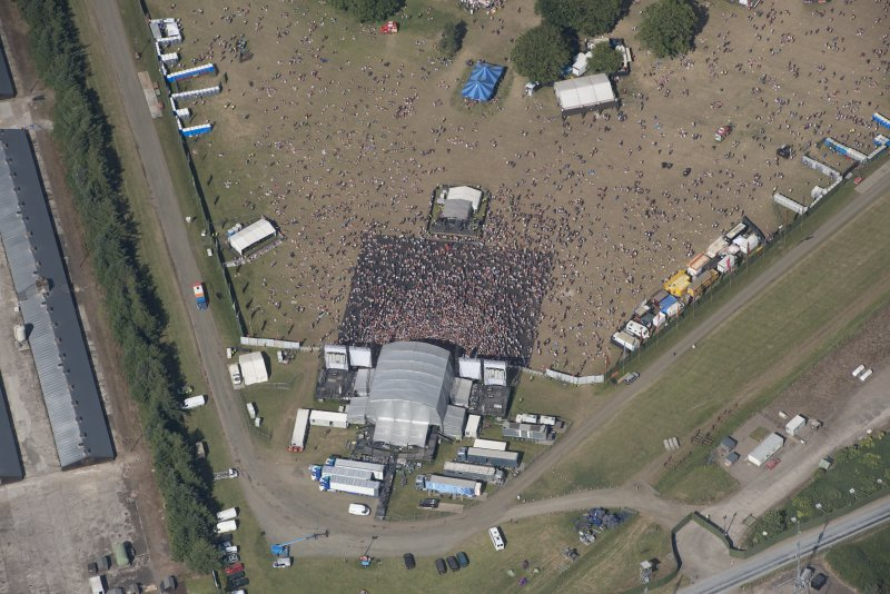 Oblique aerial view of the T in the Park festival at Balado, looking NE.