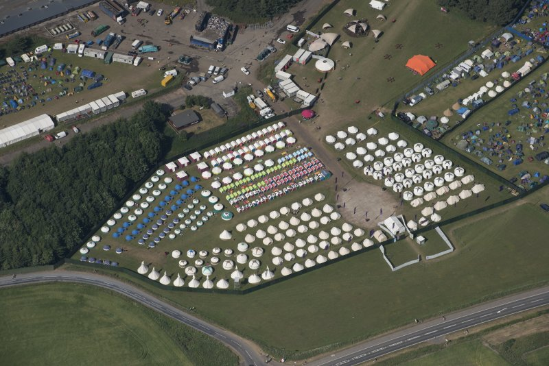 Oblique aerial view of the T in the Park festival at Balado, looking NNE.