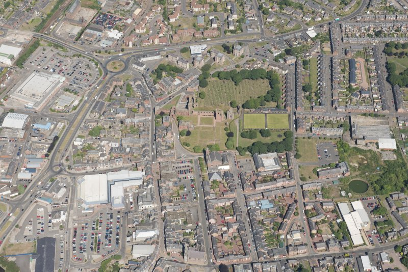 Oblique aerial view centred on Arbroath Abbey, looking NNW.