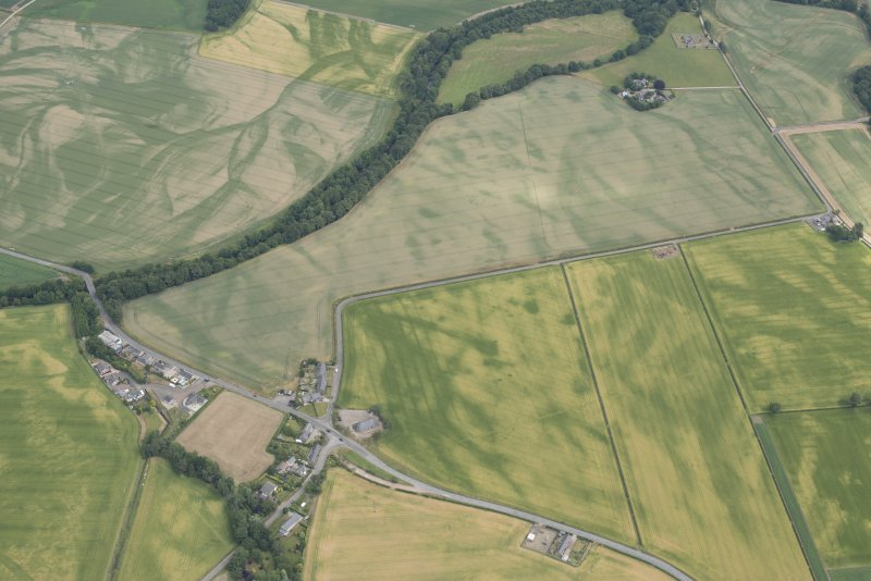 Oblique aerial view centred on the cropmarks at Smiddyhill, Inchbare and Ballownie, looking ENE.