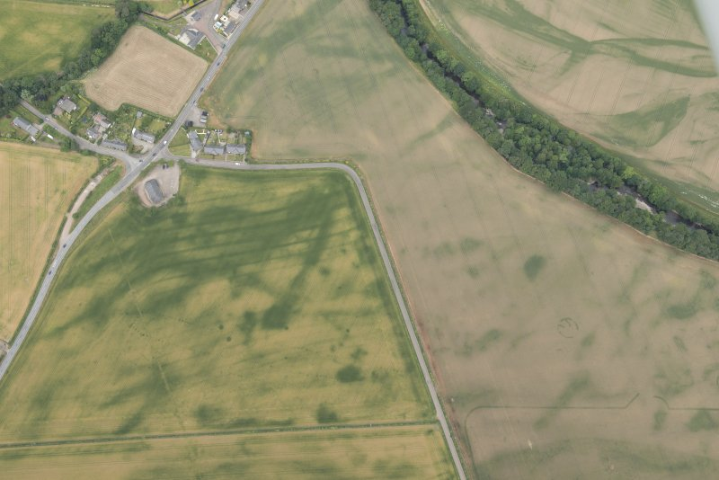 Oblique aerial view of the cropmarks at Inchbare and Smiddyhill, looking NW.