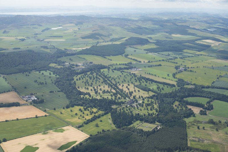 General oblique aerial view centred on Glamis Castle with the Sidlaw Hills in the background, looking SW.