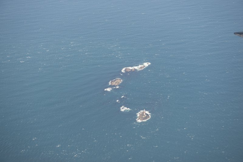 General oblique aerial view of Dun Artach lighthouse, looking to the W.