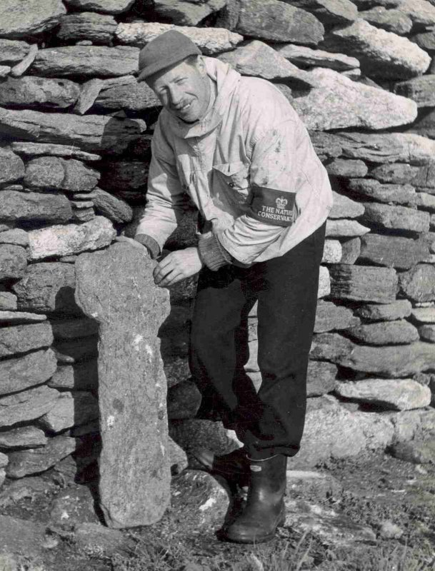 Photograph of J MacGeoch at St Ronan's church, west gable.
