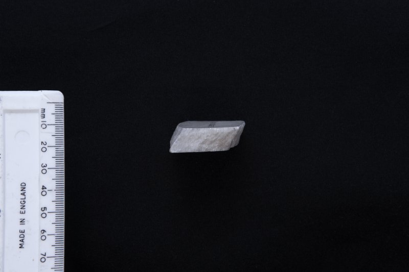 Section of fragment of marble sheet (with scale)