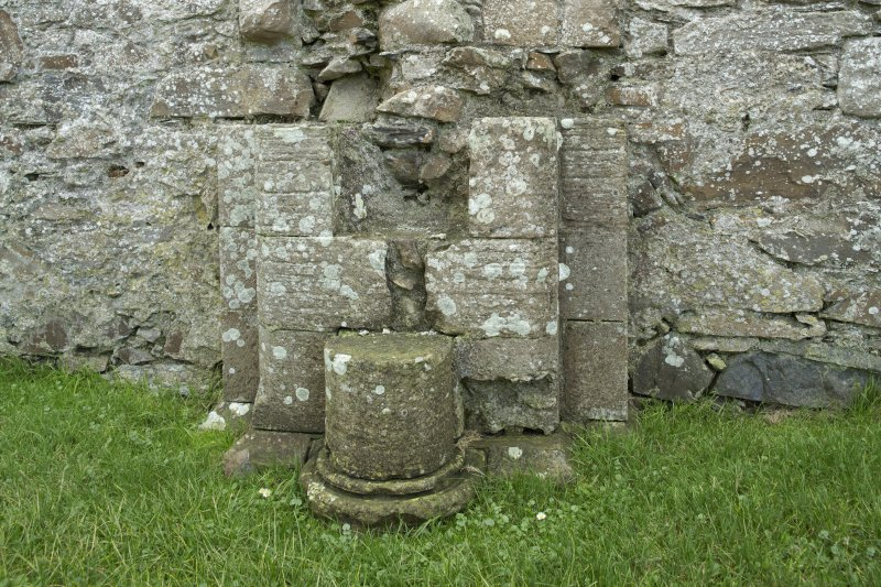 Detail of engaged column base within former east arcade of south transept.