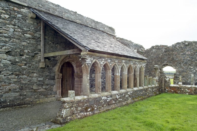 View of reconstructed east cloister arcading and roof taken from the north.