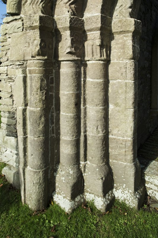 Exterior. South doorway. Detail of south west grouping of inner/outer facing capitals