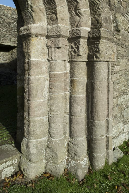 Exterior. South doorway. Detail of north east grouping of inner/outer facing capitals