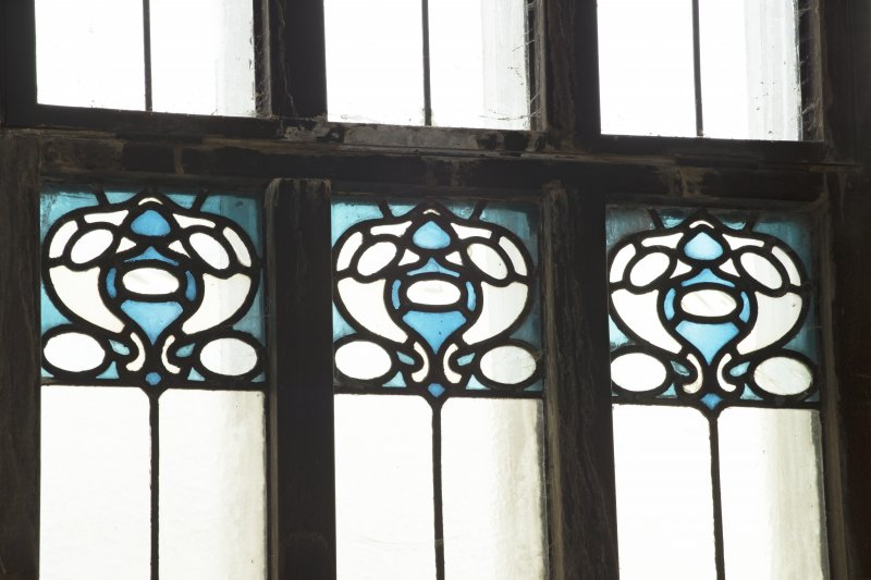Ground floor,  Music Room, detail of stained glass behind Mackintosh organ