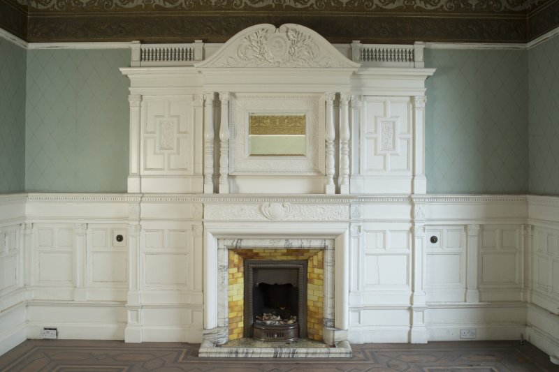 Ground floor, drawing room, view of south wall with fireplace and panelling